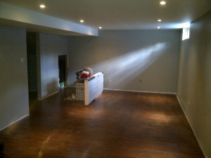 Ottawa Home Renovations Contractor Sylvie and Ed basement renovation day 13 pot lights and laminate floor finished