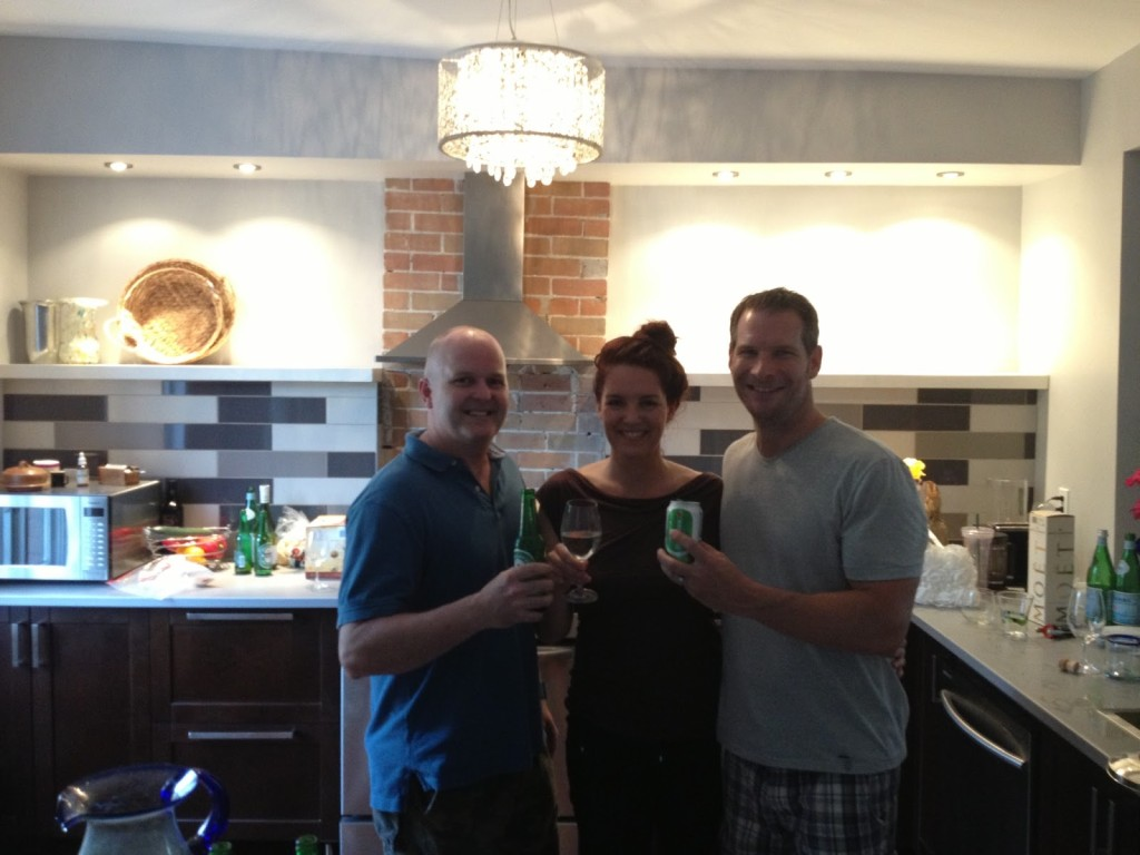 At Jacqueline and Ted's housewarming, toasting the new kitchen. Check out the angle of the bulkhead behind us. Oh the joys of older homes.