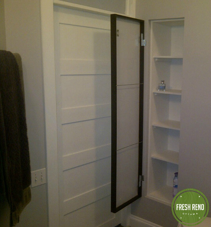 The bathroom is adjacent to a hallway closet, which Ted and Jacqueline didn't need. So, we closed-off the hall way closet, then used the space to create a custom bathroom closet.
