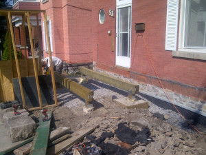 Paul Gratton Fresh Reno Ottawa Home Renovations 2-storey deck Day 7 - 4 footings and 2 triple beams