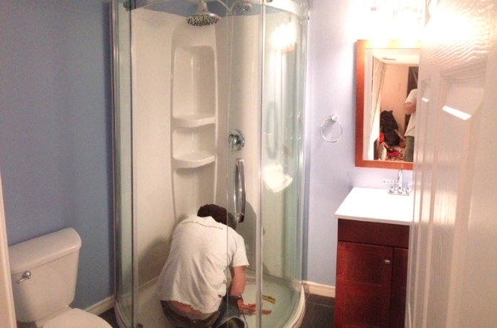 Day 12. Everything is installed and Donald is caulking the shower. Just paint touch ups to do and a good clean.