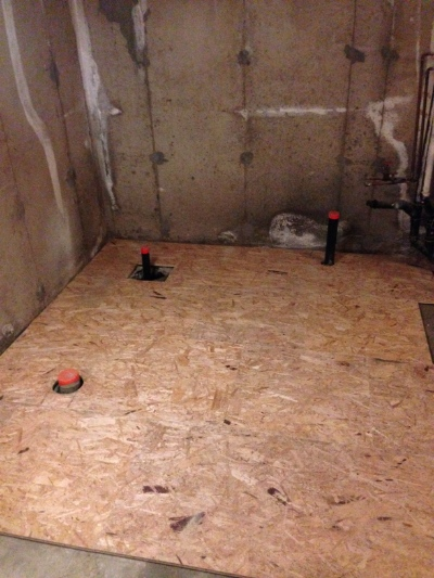Day 5: Dricore is laid, leaving the plumbing exposed. Next we'll frame the room.