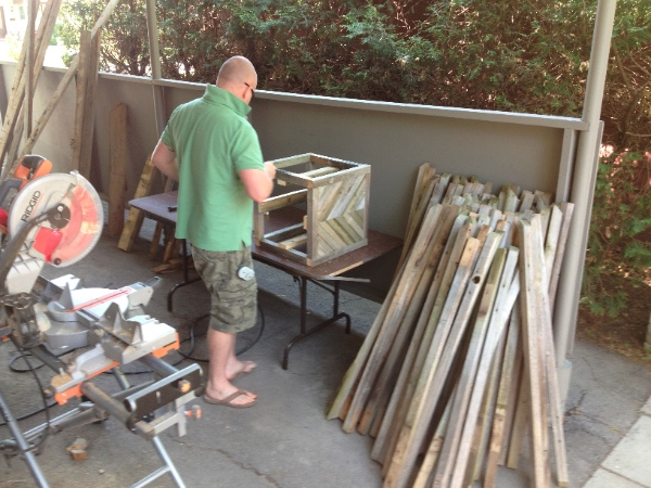 Planter box building gets underway, making use of the old railing.