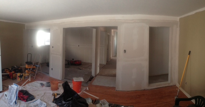 Day 12: Drywall installation is complete and the first coat of mud is almost done.
