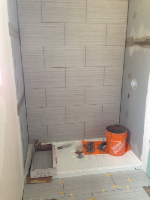 Day 7: Shower stall tile installation.