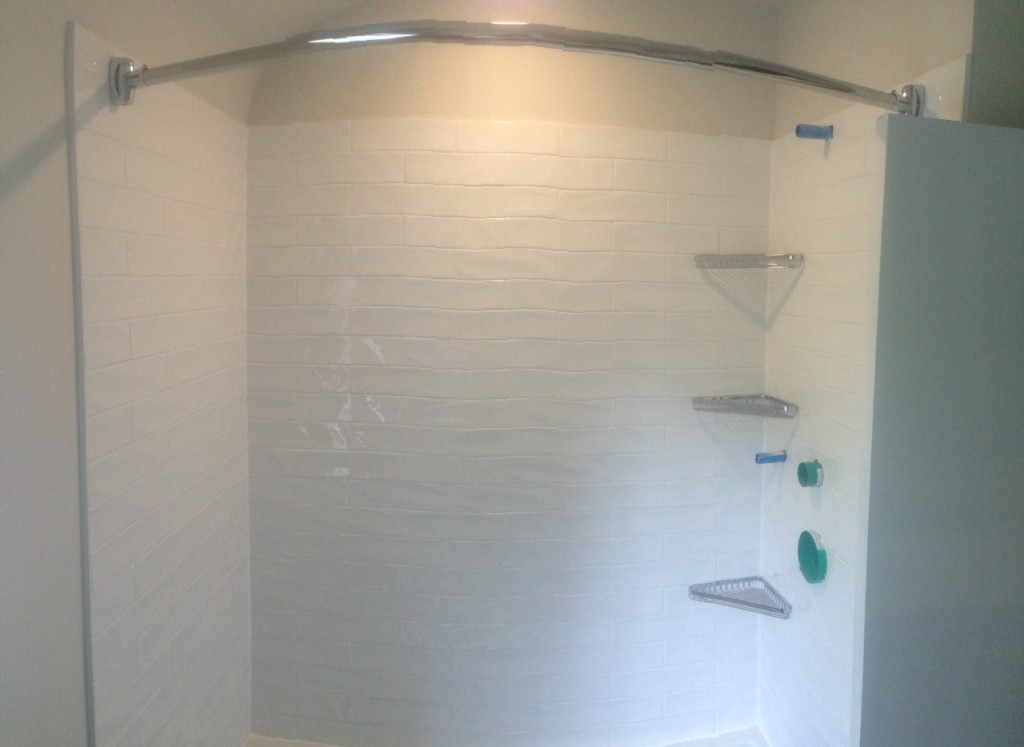 Day 11: Shower complete. The plumber will be back to install the plumbing fixtures.