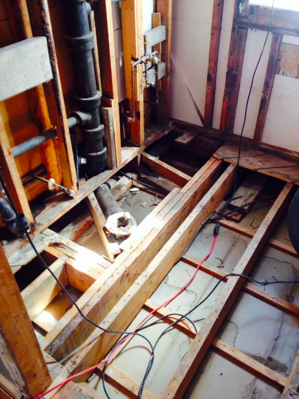Day 2: Bathroom demolished down to the studs. Plumbing re-routed since the new tub will be in a new location.