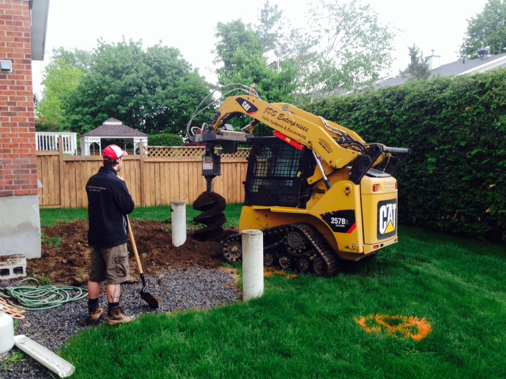 Day 2: When you have 7 six-foot deep, two feet wide holes to dig AND enough access to the yard, you bring in the big toys.