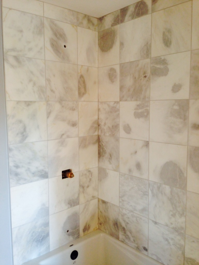 Day 15: Stunning marble tiles in Jane's bathroom are grouted.