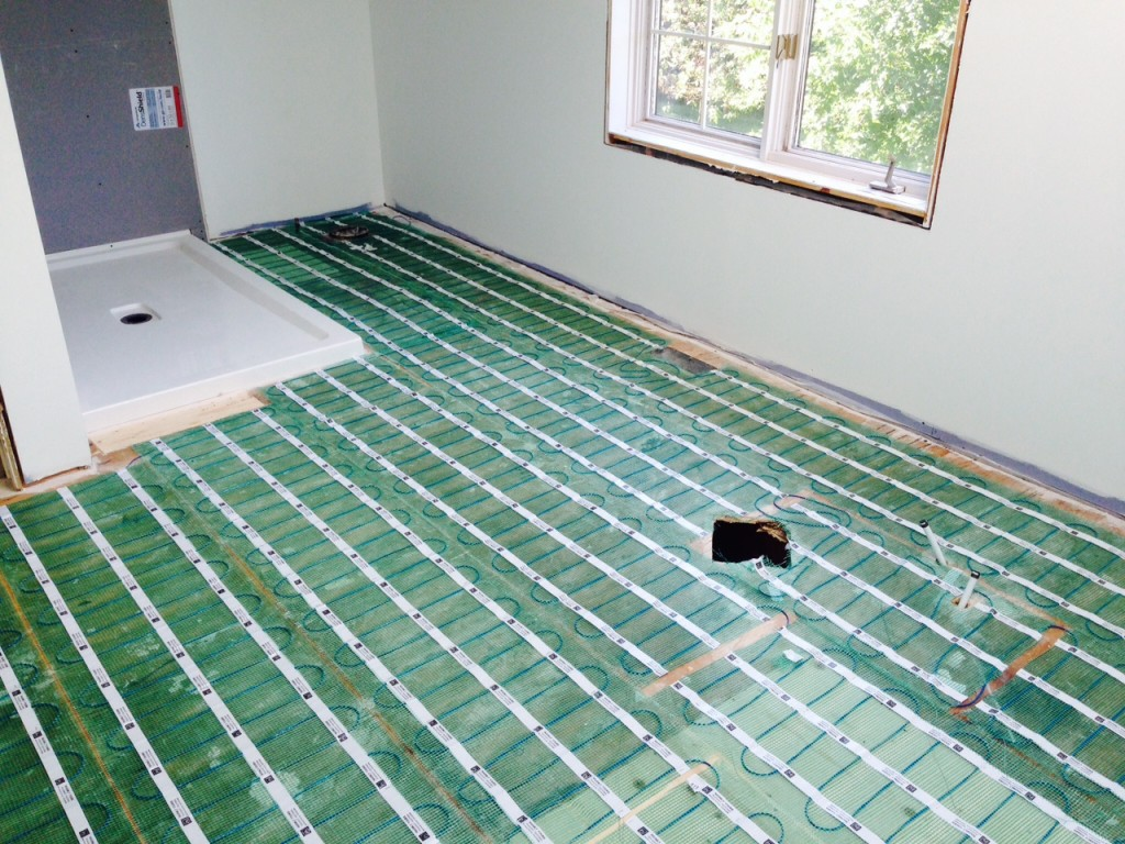 Day 15: Warmly Yours under tile heat system for Roger and Margaret's ensuite bathroom.