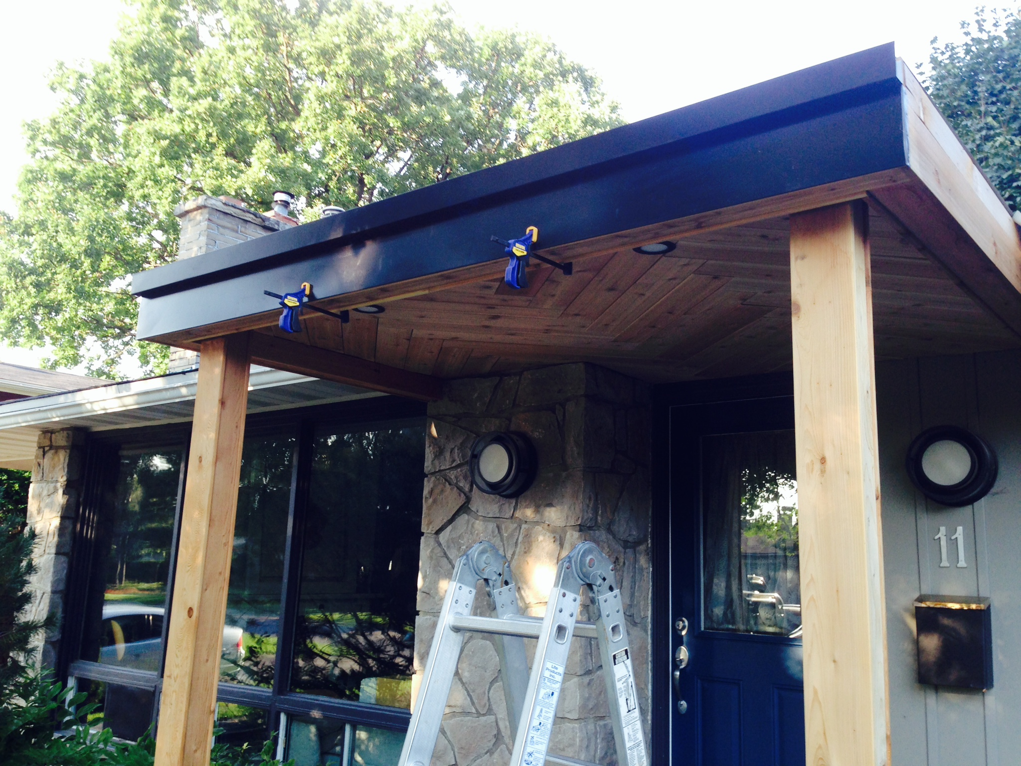 Flat roof bungalow porch with herringbone detail fresh reno for Flat roof porches