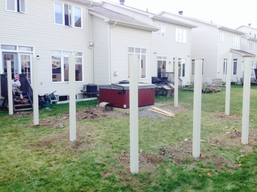 Day 3: Manually carried 1 tonne (yes 1,000 kg) of cement bags into the backyard today, mixed them, then set the fenceposts.