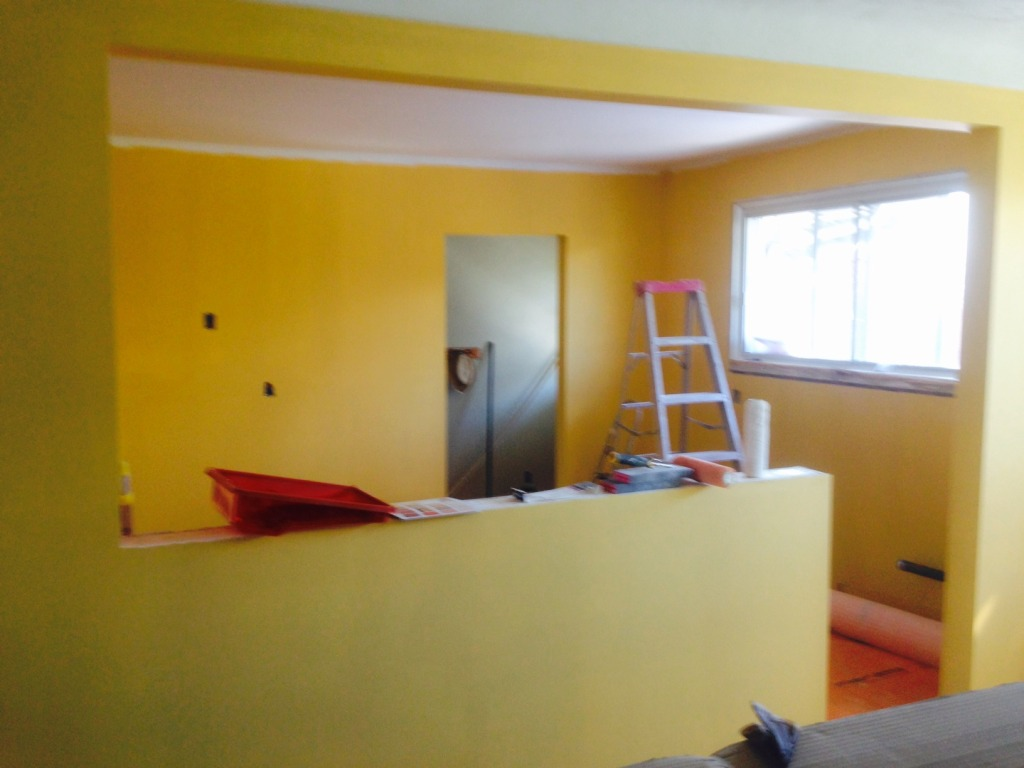 "Kitchen reno day 11: The walls are sanded, primed and painted with one coat of ""Kernel"" yellow."