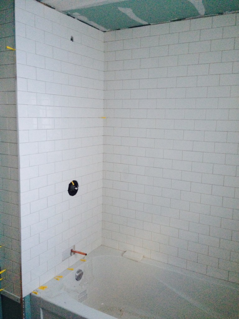 Day 10. Tiles are going up in the bathroom. All walls are getting tiled top to bottom. No paint, just wall tiles all around. It's looking fantastic.