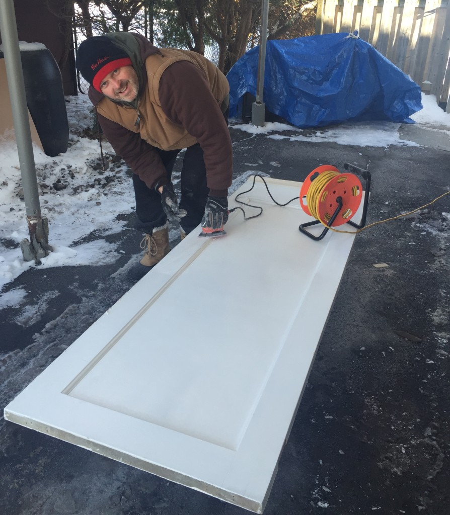 Sunday: Making Sarah and Rob's bathroom door into a pocket door. In my carport in -15C.