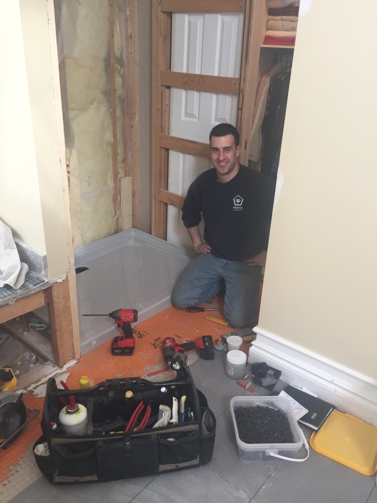 Day 4: Andrew, owner of Penta Plumbing Ltd., instaling the shower base. We always work with licensed tradespeople.