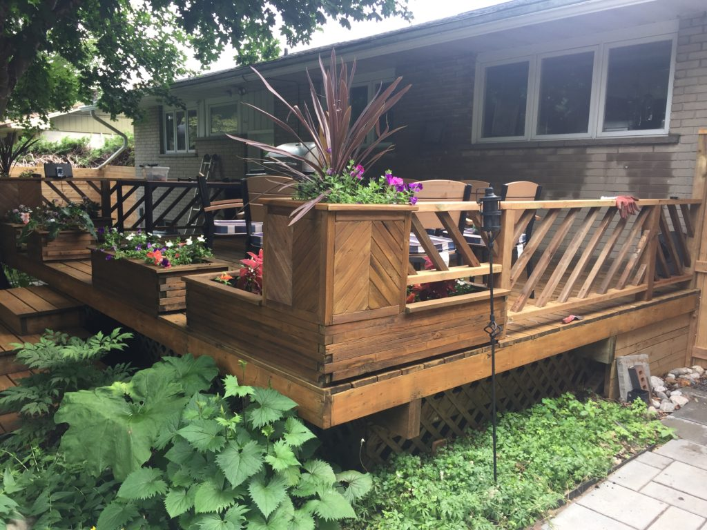 The chevron railing works well with the chevron planter boxes I built a few years ago. Both the railing and the boxes repurposed the wood from the previous railing.