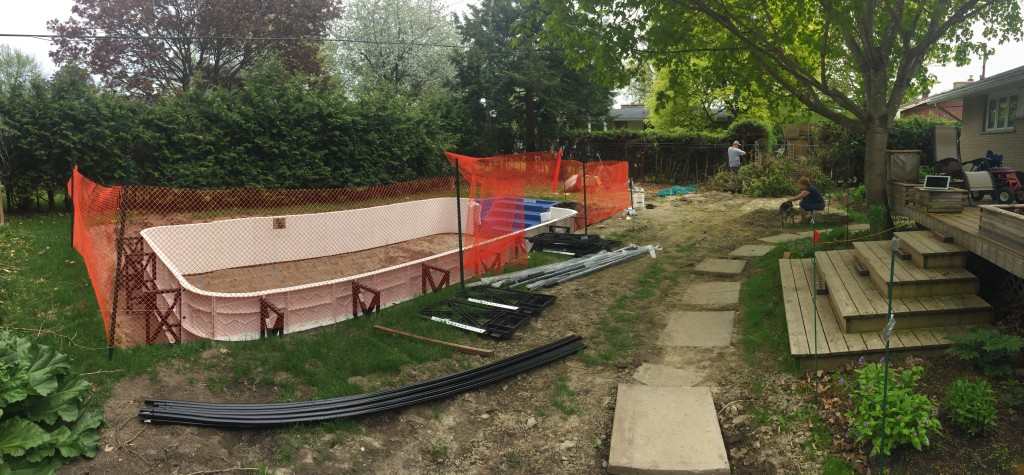 Pool walls installed, safety fence.