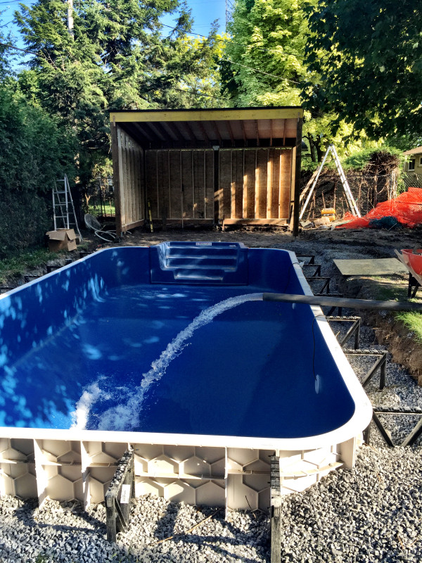 Big day!! There is gravel part-way up the pool wall. The pool is filled, then the rest of the gravel goes in.