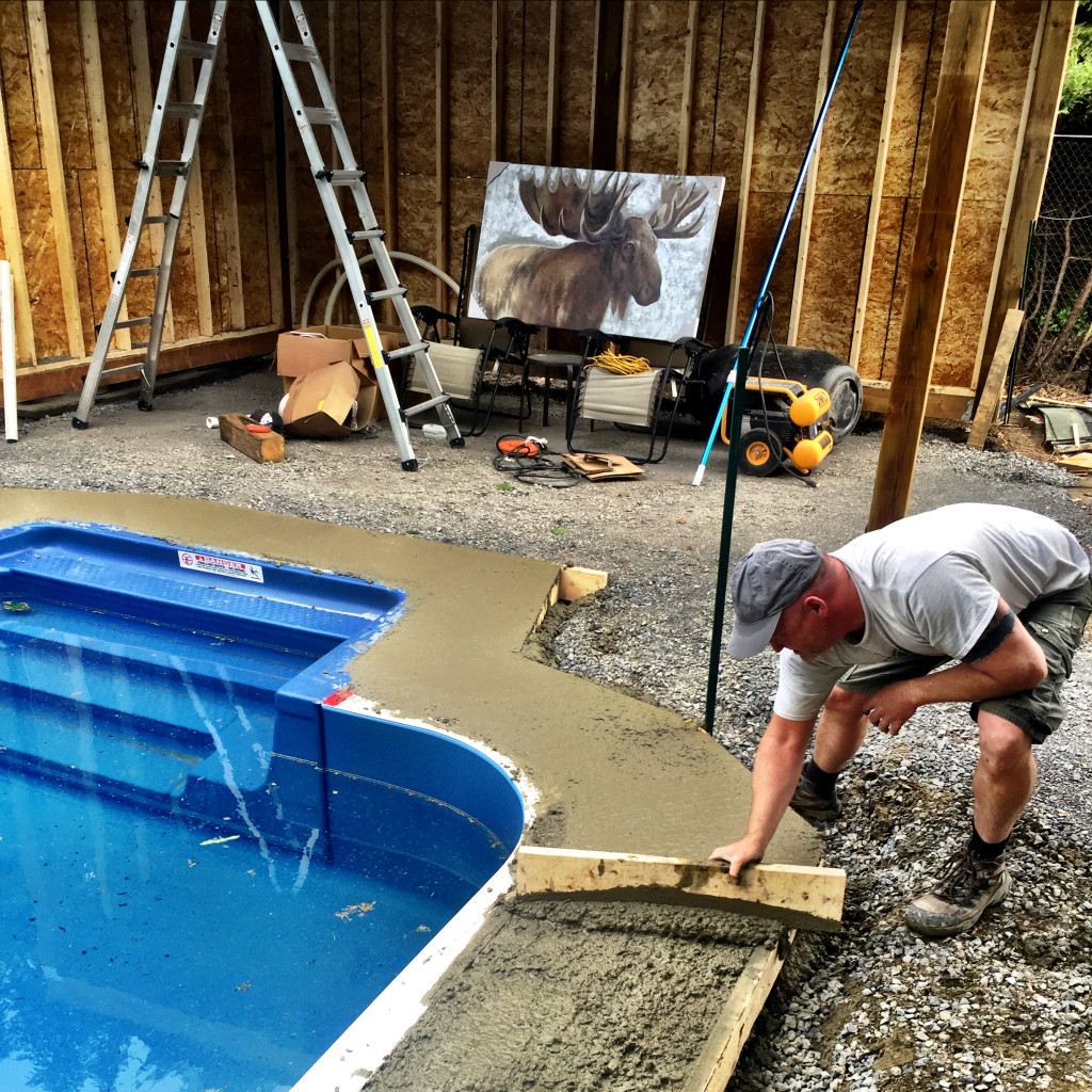 We're getting there! This concrete secures the wall and support system together, and provides a base for the stone around the pool. And yes, Mr. Moose in the background will be hanging in the pool house.