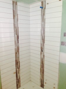 Day 5: Tiling the shower. Joe is a tall man, so we ensured that the plumber put the shower head plumbing up high.