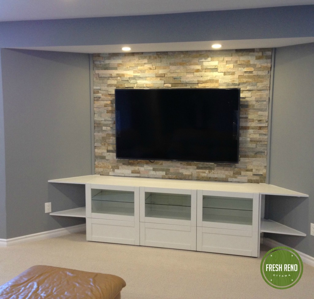 Completed entertainment area complete with corner shelves and recessed lights to highlight the stone.