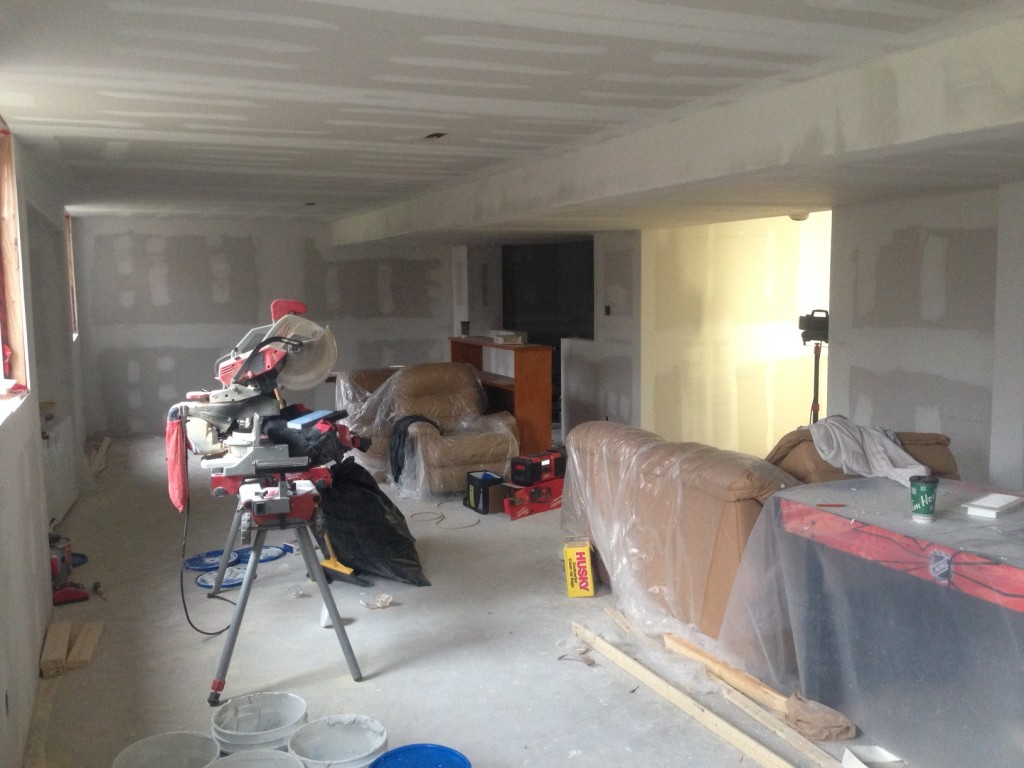 Day 5: Basement renovation walls are framed, drywalled, mudded and sanded.