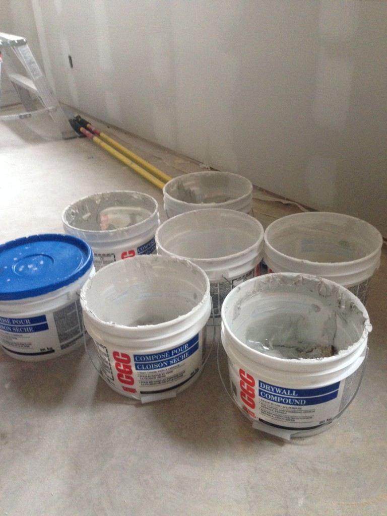 Many buckets of drywall mud for all the new basement walls.