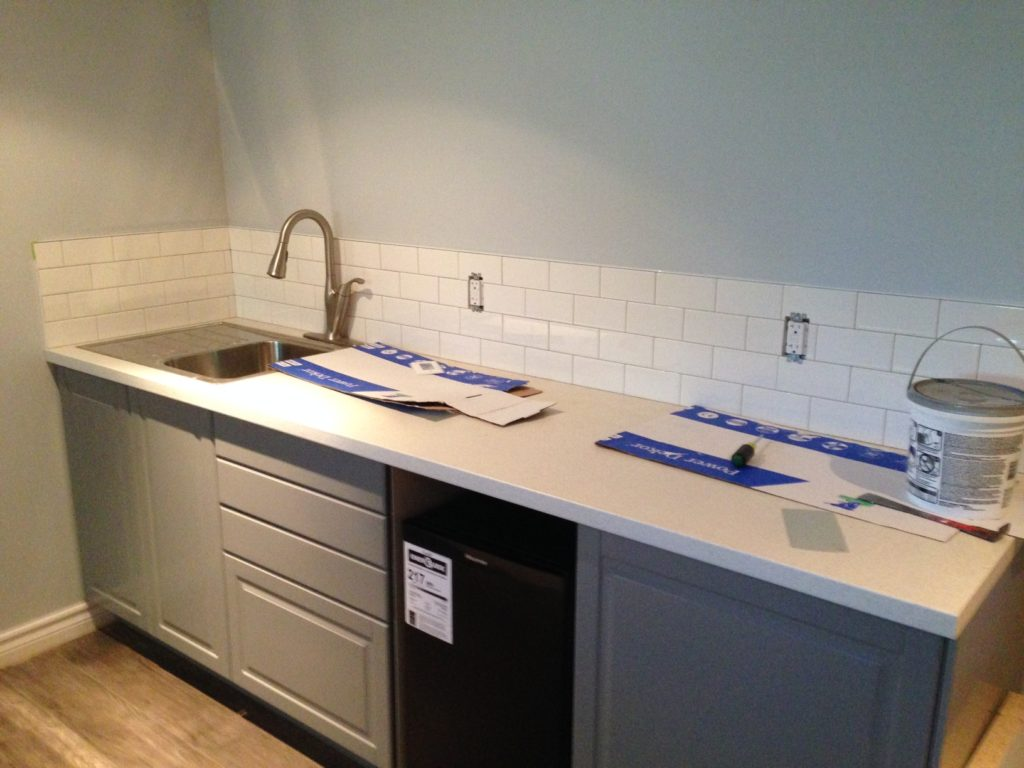 Basement reno day 11: Subway tile installed for the kitchenette backsplash. The basement will be finished this week.