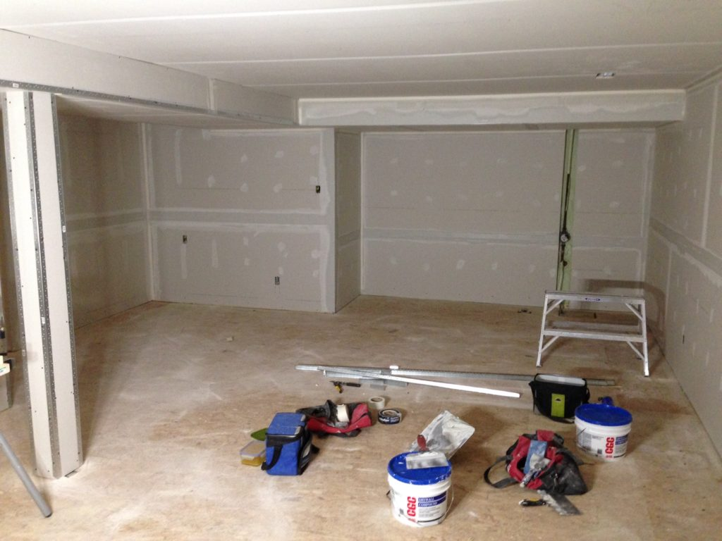 Day 10 by the numbers: 54 sheets of drywall, 500 feet of tape, 2 buckets of mud, and 176 feet of metal corner bead.